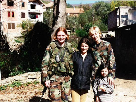 Michelle Rasmusson, Baileys Harbor, left, was first deployed in 2000 to Kosovo, where she helped secure school supplies for children with the aid of a translator and other fellow civil affair reservists.