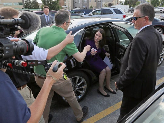 Steven Avery's attorney, Kathleen Zellner, takes a business card from a reporter at the Manitowoc County courthouse in August of 2016.