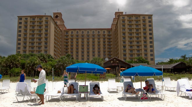 Guests of The Ritz-Carlton in Naples relax on Vanderbilt Beach last week.