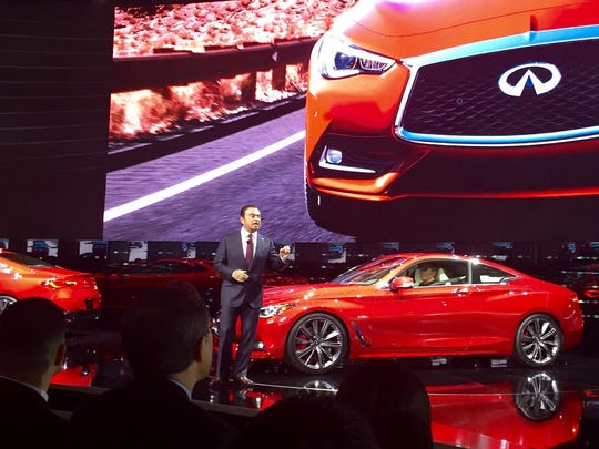 Carlos Ghosn unveils the Infiniti Q60 at the Detroit auto show on Monday, Jan. 11, 2016.