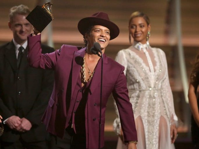 Bruno Mars accept the award for record of the year for ìUptown Funkî at the 58th annual Grammy Awards on Monday, Feb. 15, 2016, in Los Angeles.