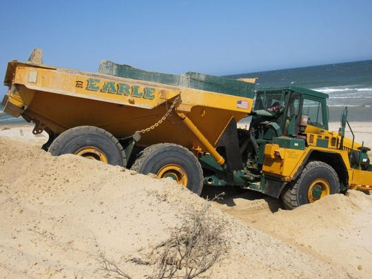 Toms River contractor Earle Asphalt dumps sand on the