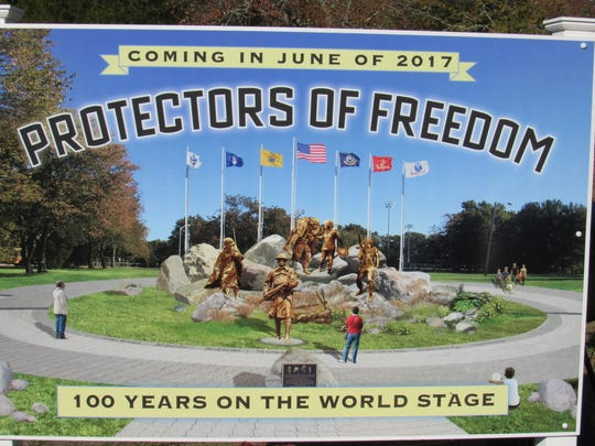 A sign at Bey Lea Park announces a new sculpture, Protectors of Freedom, that will be unveiled there next June.