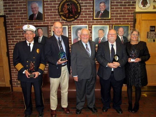 Mayor Thomas F. Kelaher (center) and Township Council members honored four long-term township employees who retired at the end of December. Those honored include: James Mercready, director of the Fire Prevention Bureau (l), Township Planner Jay Lynch, Records Manager Greg Horback, and police department employee Diane Mastronardy.