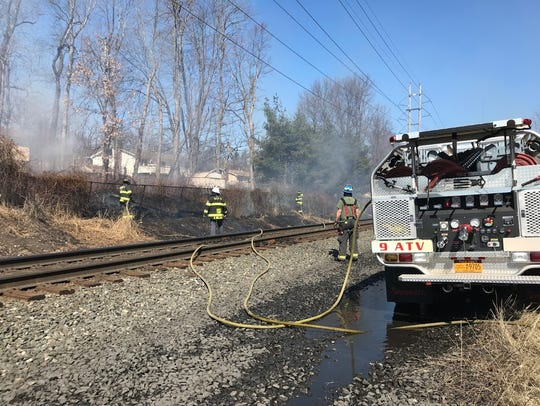 Firefighters extinguished a brush fire that spread