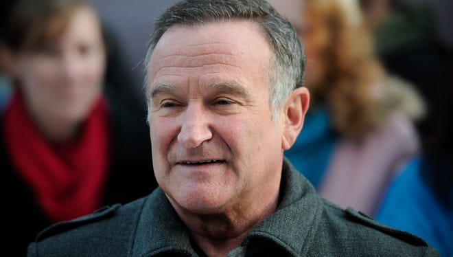 """US actor Robin Williams arrives for the European premiere of """"Happy Feet Two"""" in central London on November 20, 2011."""