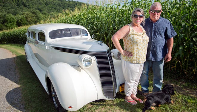 Joanne Barello and Christopher Lord, of Chenango County Coach, with their 1937 Studebaker Dictator.
