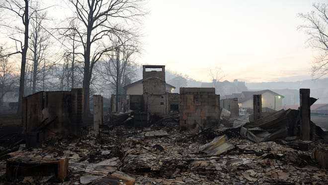Apartments across the street from Gatlinburg Church of Christ were shells of buildings Nov. 29, 2016, after wildfires mixed with high winds on the night before to cause widespread damage in the Gatlinburg, Tenn., area.