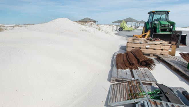 Beach asphalt removal equipment sits idle along newly cleaned sands of Gulf Islands National Seashore west of Navarre on Wednesday, March 7, 2018.  Work will resume after shorebird nesting season in September.
