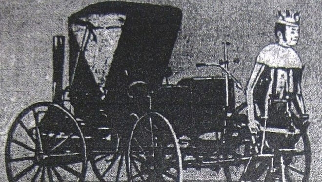 The Steam King with its wagon and mechanical man, around 1875.