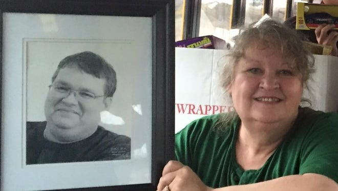 Leneta Glass, a long-time Lansing radio broadcaster known professionally as Jordan Lee, died Saturday. She is shown holding a photo of her late husband, Jay McCrae.