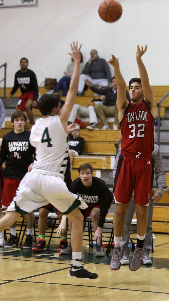 Fox Lane's  Nick Rosati (32) puts up a 3-point shot