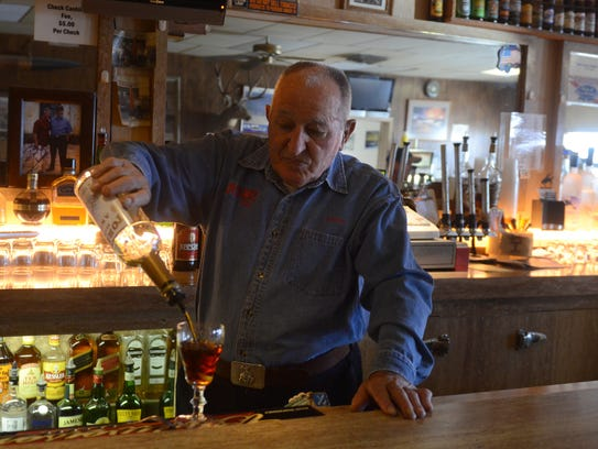 Bruno Selmi pours a drink at his bar in 2013. He died