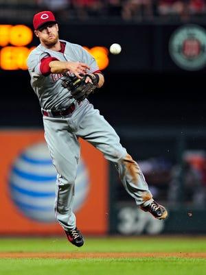 Cincinnati Reds shortstop Zack Cozart (2) throws on the run to get St. Louis Cardinals third baseman Matt Carpenter (not pictured) during the fifth inning at Busch Stadium.