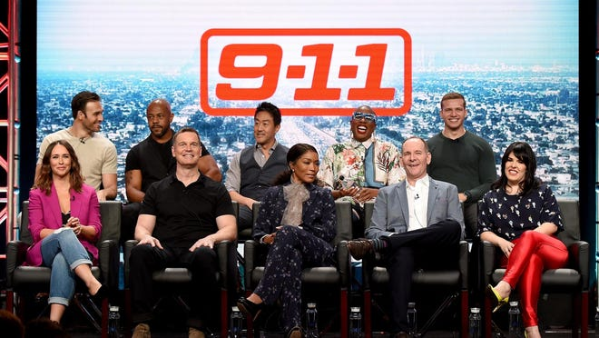 """From top left to bottom right, """"9-1-1"""" cast members Ryan Guzman, Rockmond Dunbar, Kenneth Choi, Aisha Hinds, Oliver Stark, Jennifer Love Hewitt, Peter Krause, co-executive producer/cast member Angela Bassett, creator/writer/executive producer Tim Minear and executive producer Alexis Martin Woodall attend a panel discussion at the 2018 Television Critics Association in Beverly Hills, California."""