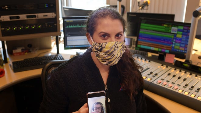 WXLO morning show producer Kyra Losora with Jen Carter on her phone screen via FaceTime July 29 at the studio.