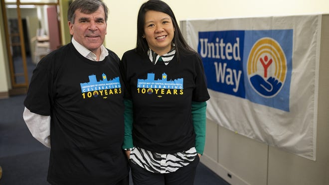 Worcester attorney AiVi Nguyen, right, and Tim Garvin, president and CEO of the United Way of Central Massachusetts, in January