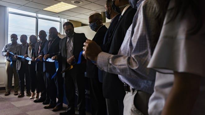 Members of Bowdoin Construction Corp. cut the ribbon at the company's new office at the Worcester Business Center on Thursday.