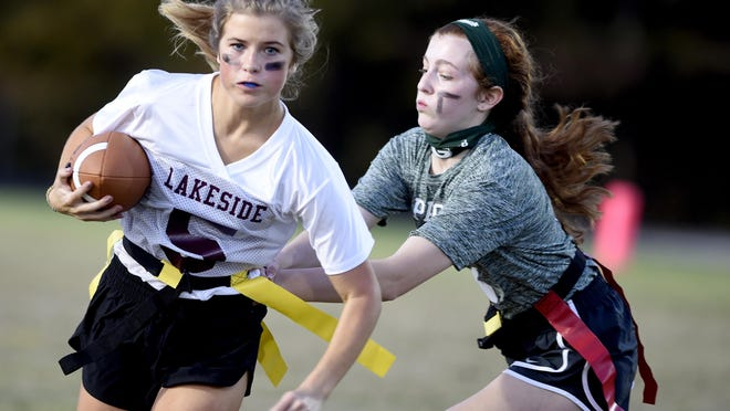 Lakeside's Brayden Sapp, right, tries to elude Greenbrier defender Brooklyn Oliver during flag football action at Greenbrier High School in Evans, Ga., Thursday evening November 5, 2020.