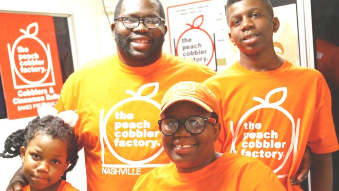 Tami Lenore and her husband, Juan Edgerton, owners of the Peach Cobbler Factory, with  their two kids.