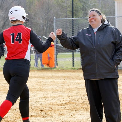 Corning Community College softball coach Stacy Johnson congratulates Amber Edwards after a home run during a softball game April 2 against Jefferson.