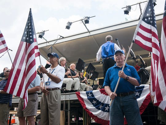 Veterans present flags as the band plays the first