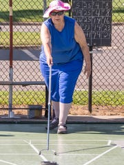 Virginia Merrian during the Michigan Shuffleboard Tournament at Bailey Park on Tuesday.