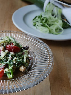 "This Greek salad is prepared with a twist made with spiralized cucumber ""noodles."""