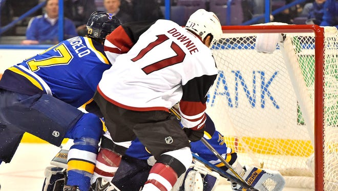 Dec 8, 2015: Arizona Coyotes right wing Steve Downie (17) scores a goal past St. Louis Blues goalie Jake Allen (34) during the first period at Scottrade Center.