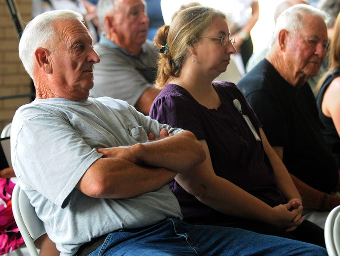 Jerry Watts, brother of Forrest County Deputy Johnny Watts who was killed in a 1976 traffic accident, left, listens Tuesday during the Law Enforcement Memorial service at the Billy McGee Law Enforcement Complex.