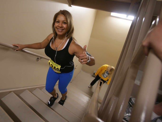 Deyanira Gottwald reaches the top of the OneAmerica Tower during the Bop to the Top event, Saturday, Jan. 18, 2014. Competitors climbed 780 stairs, 515 feet and 36 floors to raise money for Riley Hospital for Children. Last year's event raised $15,000.