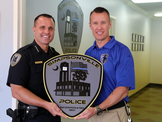 Simpsonville Police Chief Keith Grounsell poses with Terry Rogers who is the first member of the new Reserve Police Officer Chaplain program.