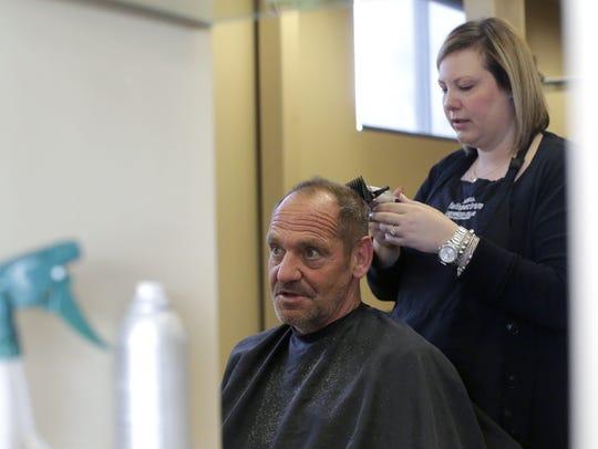 Ken Smith gets a haircut by Salon Spa Aura stylist