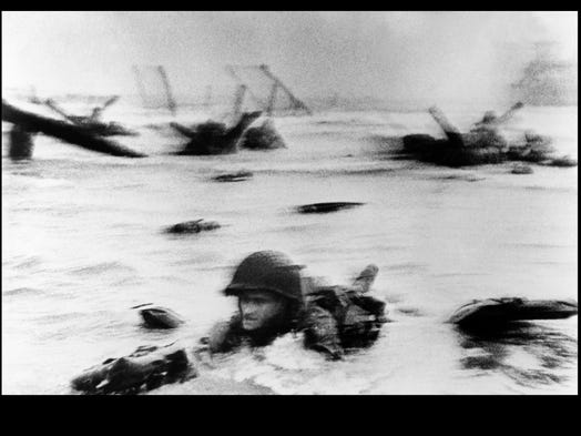 A soldier from the Army's 16th Infantry Regiment makes his way toward Omaha Beach in an image by legendary war photographer Robert Capa, who came ashore with the troops. Capa was prepared with two cameras and a lot of film. He took 108 pictures within the first couple of hours of the invasion. He made it out alive, but one of LIFE magazIne's technicians damaged the film, and only eight frames were salvaged. <p><br /></p>