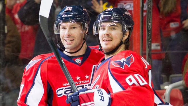 Troy Brouwer, left, celebrates his first-period goal with Marcus Johansson.