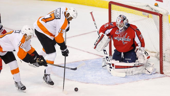 Capitals goalie Braden Holtby  makes a save on Flyers right wing Wayne Simmonds in the third period.