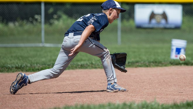 Noah LaValley fields the ball during the Marysville Vikings 10-and-under baseball practice Tuesday, July 19, 2016 at Marysville City Park.