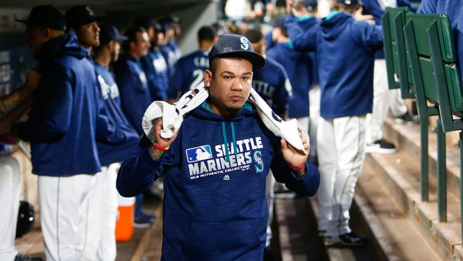 Seattle Mariners starting pitcher Felix Hernandez (34) walks in the dugout before the first inning against the Oakland Athletics at Safeco Field. Seattle defeated Oakland, 3-2.