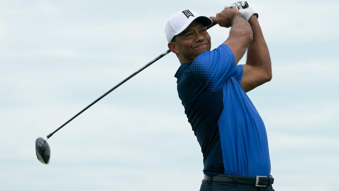 Tiger Woods hits his tee shot during Monday's practice round of the Hero World Challenge.