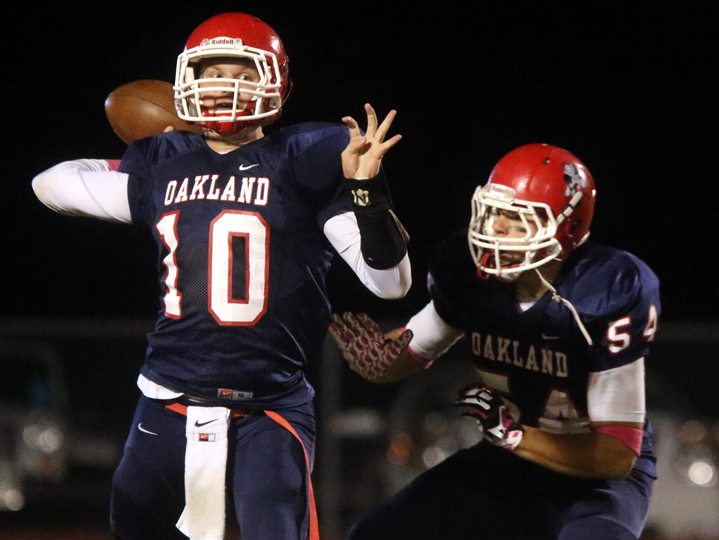 Oakland quarterback Brendan Matthews (10) drops back