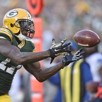 Green Bay Packers wide receiver Davante Adams (17) can't secure this fourth quarter pass against the Detroit Lions at Lambeau Field November 15, 2015.
