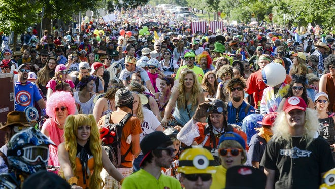 Thousands flood the streets of Fort Collins for New Belgium's annual Tour de Fat Saturday, August 30, 2014.