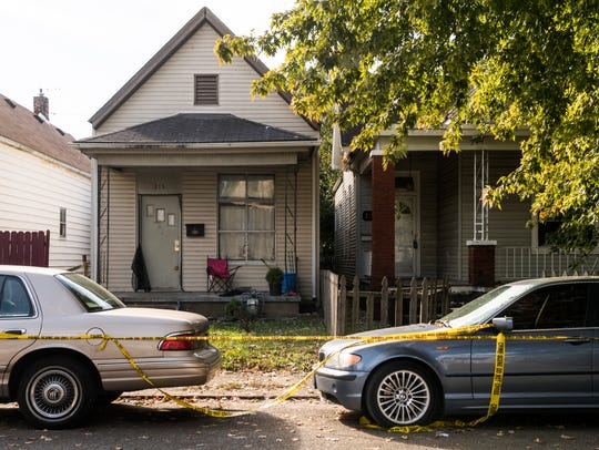 Crime scene tape blocks off the scene of a double homicide