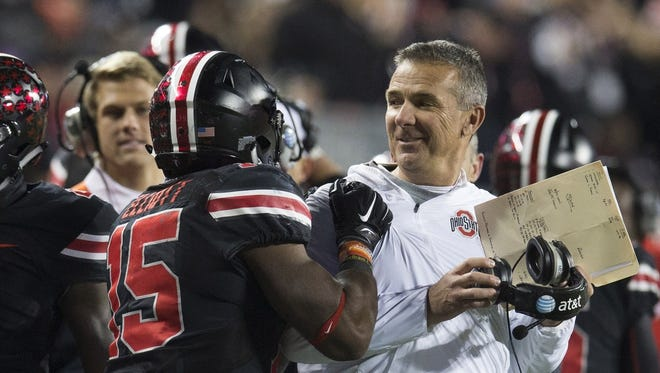 Urban Meyer, right, and Ohio State are 7-0 and will stay at No. 1 this week.