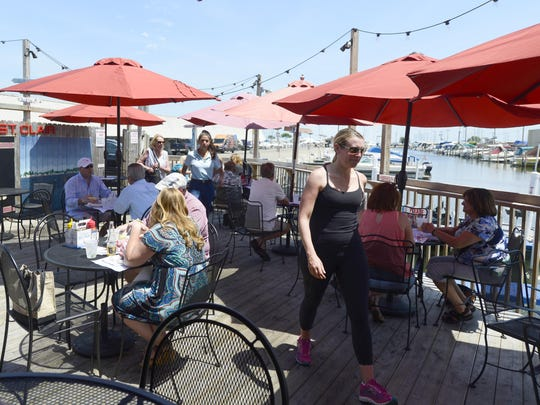 Customers can choose from numerous seating options at Mike's, including the covered porch and deck on the canal that runs by the restaurant.