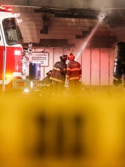 Firefighters at the scene of a Friday night fire at