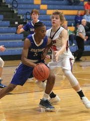 Senior guard Elijah Cobb, one of two returning starters from St. Peter's regional finalist team, tries to shake the pressure from Galion's Gage Lackey in Saturday's Richland Source Challenge at Ontario High School.