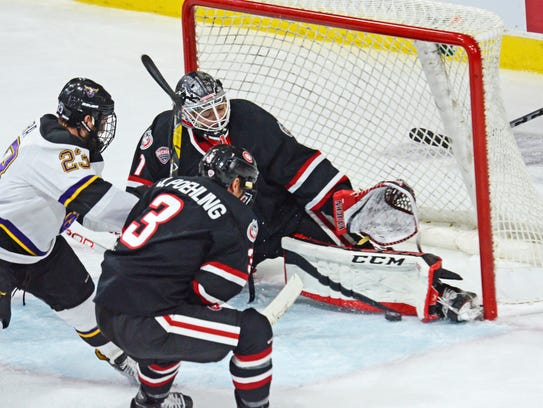 St. Cloud State goalie Jeff Smith makes a pad save