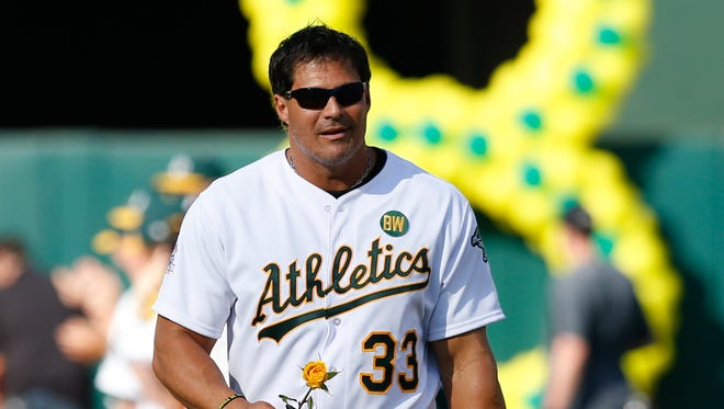Jose Canseco takes the field during the celebration of the 1989 Oakland Athletics World Series title before a game in July of 2014.