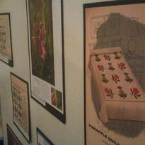 """A selection of the quilts featured in the """"Pieces of the Past: Quilts Tell a Story"""" exhibit at the Marathon County Historical Society."""